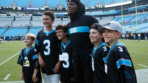 <p>               Carolina Panthers quarterback Cam Newton poses with children before the first half an NFL preseason football game against the Buffalo Bills, Friday, Aug. 16, 2019, in Charlotte. (AP Photo/Brian Blanco)             </p>