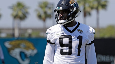 <p>               FILE - In this May 21, 2019, file photo, Jacksonville Jaguars defensive end Yannick Ngakoue (91) prepares for drills during an NFL football practice in Jacksonville, Fla. (AP Photo/John Raoux, File)             </p>