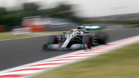 <p>               Mercedes driver Lewis Hamilton of Britain steers his car during the first practice session of the Hungarian Formula One Grand Prix at the Hungaroring racetrack in Mogyorod, northeast of Budapest, Hungary, Friday, Aug. 2, 2019. The Hungarian Formula One Grand Prix takes place on Sunday. (AP Photo/Laszlo Balogh)             </p>