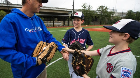 <p>               David Fox, from left, with his sons Dewey and Jimmy put their hands together as they wrap up practicing baseball at a nearby baseball field in northeast Washington, Friday, Aug. 23, 2019. David Fox and his wife, Mary Ann, have a rule for their sons, 11-year-old Dewey and 8-year-old Jimmy: They have to play a team sport. The kids get to choose which one. Dewey tried soccer and Jimmy had a go at flag football, but every spring and fall, their first choice is baseball. (AP Photo/Manuel Balce Ceneta)             </p>