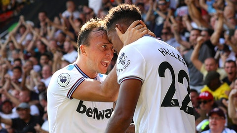 <p>               West Ham United's Sebastien Haller, right, celebrates scoring his side's third goal of the game with team mates during the English Premier League soccer match between Watford Town and West Ham united at Vicarage Road Stadium, Watford, England. Saturday Aug, 24, 2019. (Aaron Chown/PA via AP)             </p>