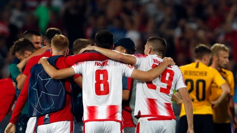 <p>               Red Star players celebrate at the end of the Champions League play-off, second leg soccer match between Red Star and Young Boys on the stadium Rajko Mitic in Belgrade, Serbia, Tuesday, Aug. 27, 2019. (AP Photo/Darko Vojinovic)             </p>