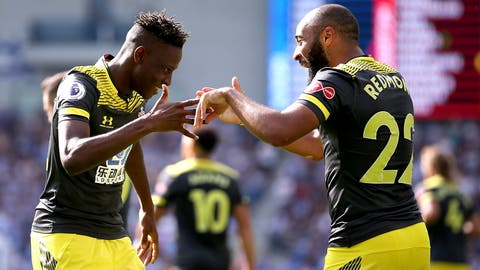 <p>               Southampton's Moussa Djenepo, left, celebrates scoring his side's opening goal with team-mate Nathan Redmond during the English Premier League soccer match between Brighton and Hove Albion and Southampton at the AMEX Arena, Brighton, England. Saturday, Aug, 24 2019 (Steven Paston/PA via AP)             </p>