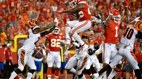 <p>               Kansas City Chiefs running back Darwin Thompson, center, is about to land on Cincinnati Bengals cornerback Darius Phillips, left, after trying to vault over  Bengals safety Brandon Wilson, right, a during the second half of an NFL preseason football game in Kansas City, Mo., Saturday, Aug. 10, 2019. (AP Photo/Ed Zurga)             </p>