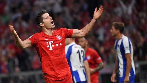 <p>               Bayern Munich's Robert Lewandowski celebrates after scoring the opening goal during the German Bundesliga soccer match between Bayern Munich and Hertha BSC Berlin in Munich on Friday, Aug. 16, 2019. (Matthias Balk/dpa via AP)             </p>