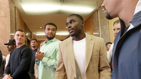 <p>               Former Wisconsin Badger football player Quintez Cephus, second from right, arrives at a press conference to reiterate his request for reinstatement to the university in Madison, Wis. Monday, Aug. 12, 2019. The former wide receiver was acquitted earlier this month of sexual assault charges stemming from a campus incident in his apartment. He was expelled from the university in March after the university's own internal investigation. A group of current team members were on hand to show support for Cephus at the event. (John Hart/Wisconsin State Journal via AP)             </p>