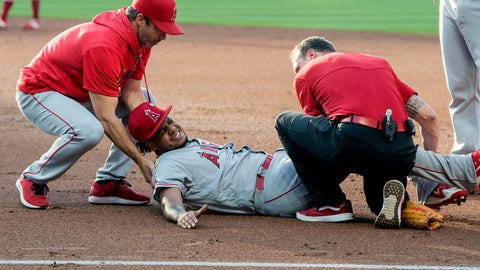 <p>               Los Angeles Angels starting pitcher Felix Pena, center, is tended to by trainers after an injury while covering first base during the second inning of a baseball game against the Cleveland Indians in Cleveland, Saturday, Aug. 3, 2019. (AP Photo/Phil Long)             </p>
