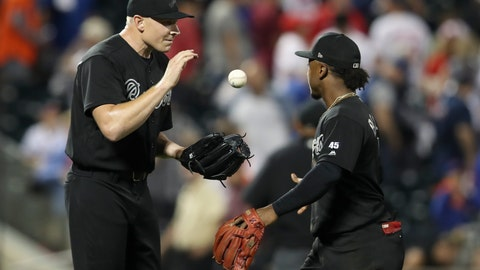 <p>               Atlanta Braves second baseman Ozzie Albies, right, tosses relief pitcher Mark Melancon a baseball as they celebrate after the Braves defeated the New York Mets 2-1 in 14 innings in a baseball game Friday, Aug. 23, 2019, in New York. (AP Photo/Mary Altaffer)             </p>