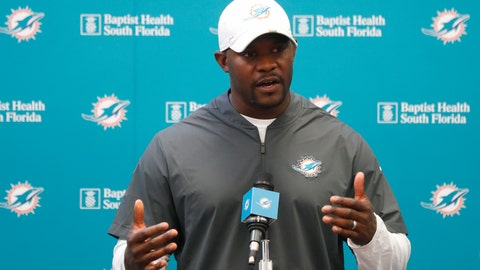 <p>               Miami Dolphins head coach Brian Flores speaks to members of the media before the start of practice at the NFL football team's training camp, Monday, Aug. 19, 2019, in Davie, Fla. Ryan Fitzpatrick is expected to start the Miami Dolphins' exhibition game this week, which suggests he's still the front-runner in his battle with Josh Rosen for the starting job. (AP Photo/Wilfredo Lee)             </p>