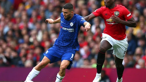 <p>               Manchester United's Paul Pogba, right, challenges Chelsea's Mateo Kovacic during the English Premier League soccer match between Manchester United and Chelsea at Old Trafford in Manchester, England, Sunday, Aug. 11, 2019. (AP Photo/Dave Thompson)             </p>