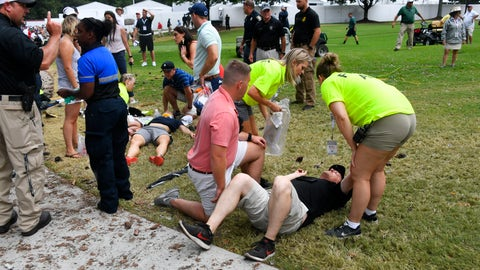 <p>               Spectators are tended to after a lightning strike on the course left several injured during a weather delay in the third round of the Tour Championship golf tournament Saturday, Aug. 24, 2019, in Atlanta. (AP Photo/John Amis)             </p>