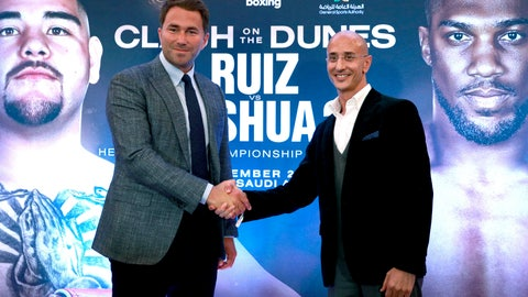<p>               Boxing promoters Eddie Hearn and managing partner of Skill Challenge Entertainment Omar Khalil shake hands, during a press conference at The Savoy Hotel, London, Monday, Aug. 12, 2019. Anthony Joshua's promoters say his world heavyweight title rematch against Andy Ruiz Jr. will take place in Diriyah, Saudi Arabia, on Dec. 7. (Ian Walton/PA via AP)             </p>
