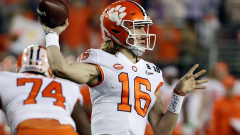 "<p>               FILE - In this Jan. 7, 2019, file photo, Clemson's Trevor Lawrence throws during the first half the NCAA college football playoff championship game against Alabama, in Santa Clara, Calif. Sure, Clemson lost all four of its ""Power Rangers"" defensive line and seven starters on defense from its title team. But the Tigers' offense, led by Heisman Trophy candidates quarterback Trevor Lawrence and tailback Travis Etienne, looks ready to operate at an even higher level than a year ago when it averaged 527 yards and 44.3 points a game.  (AP Photo/Chris Carlson, File)             </p>"