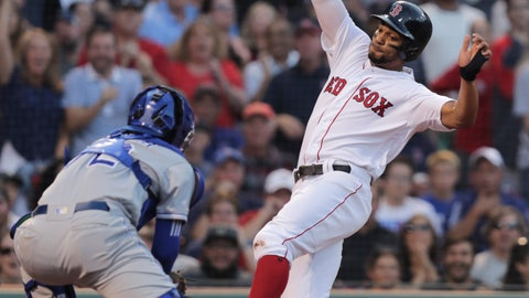 <p>               Kansas City Royals catcher Meibrys Viloria, left, sets to tag out Boston Red Sox's Xander Bogaerts, who tried to score on a double by Andrew Benintendi, during the first inning of a baseball game at Fenway Park in Boston, Monday, Aug. 5, 2019. (AP Photo/Charles Krupa)             </p>