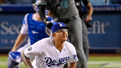 <p>               Arizona Diamondbacks' Carson Kelly, top, hits a solo home run as Los Angeles Dodgers relief pitcher Julio Urias reacts during the 11th inning of a baseball game Friday, Aug. 9, 2019, in Los Angeles. (AP Photo/Mark J. Terrill)             </p>