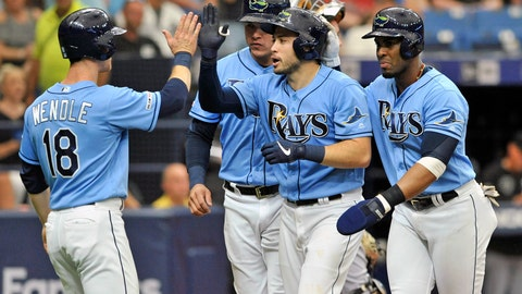 <p>               FILE - In this July 21, 2019, file photo, from left to right, Tampa Bay Rays' Joey Wendle, Avisail Garcia, Travis d'Arnaud and Yandy Diaz celebrate d'Arnaud's grand slam off Chicago White Sox starter Dylan Cease during the second inning of a baseball game in St. Petersburg, Fla. Travis d'Arnaud is making the most of an opportunity to jumpstart his career with the Tampa Bay Rays, who are getting a lot more production from him than they anticipated when they acquired the 30-year-old catcher for a mere $100,000. (AP Photo/Steve Nesius, File)             </p>