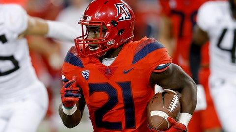 <p>               Arizona running back J.J. Taylor (21) runs during an NCAA college football game against Oregon, Saturday, Oct. 27, 2018, in Tucson, Ariz. Arizona is looking for more consistency after a disappointing first season under coach Kevin Sumlin. The Wildcats return several key players, led by quarterback Khalil Tate and running back J.J. Taylor. Arizona opens its season playing at Hawaii on Aug. 24. (AP Photo/Rick Scuteri)             </p>