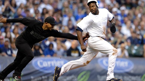 <p>               Milwaukee Brewers' Lorenzo Cain, right, is tagged out by Arizona Diamondbacks' Eduardo Escobar after being caught in a rundown during the third inning of a baseball game Saturday, Aug. 24, 2019, in Milwaukee. (AP Photo/Aaron Gash)             </p>