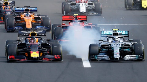 <p>               Red Bull driver Max Verstappen, left, of the Netherlands, and Mercedes driver Valtteri Bottas, of Finland, challenge for the first position after starting during the Hungarian Formula One Grand Prix at the Hungaroring racetrack in Mogyorod, northeast of Budapest, Hungary, Sunday, Aug. 4, 2019. (AP Photo/Laszlo Balogh)             </p>