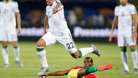 <p>               FILE - In this July 7, 2019 file photo Algeria's Ismael Bennacer, top center, and Guinea's Ibrahim Traore fight for the ball during the African Cup of Nations round of 16 soccer match between Guinea and Algeria in 30 June stadium in Cairo, Egypt. AC Milan Serie A club announced Sunday, Aug. 4, 2019, it has signed the Algerian midfielder Bennacer from Empoli with a five-year contract. (AP Photo/Ariel Schalit)             </p>