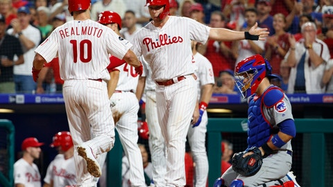<p>               Philadelphia Phillies' J.T. Realmuto, left, celebrates his grand slam with Rhys Hoskins, center, as Chicago Cubs catcher Victor Caratini, right, looks down during the third inning of a baseball game Wednesday, Aug. 14, 2019, in Philadelphia. (AP Photo/Chris Szagola)             </p>
