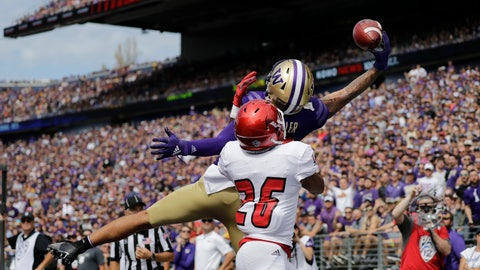 <p>               Washington's Aaron Fuller makes a one-handed catch for a touchdown over Eastern Washington's Darreon Moore (26) in the first half of an NCAA college football game Saturday, Aug. 31, 2019, in Seattle. (AP Photo/Elaine Thompson)             </p>