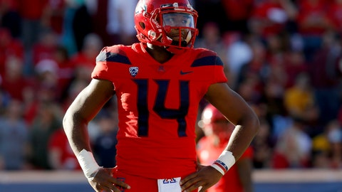 <p>               Arizona quarterback Khalil Tate (14) looks on in the second half during an NCAA college football game against Arizona State, Saturday, Nov. 24, 2018, in Tucson, Ariz. Arizona is looking for more consistency after a disappointing first season under coach Kevin Sumlin. The Wildcats return several key players, led by quarterback Khalil Tate and running back J.J. Taylor. Arizona opens its season playing at Hawaii on Aug. 24. (AP Photo/Rick Scuteri)             </p>