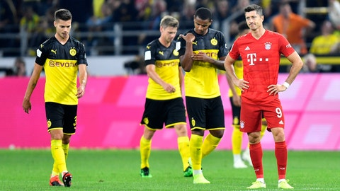 <p>               Bayern's Robert Lewandowski, right, reacts after Dortmund's Jadon Sancho scoring his side's second goal during the German Supercup final soccer match between Borussia Dortmund and Bayern Munich in Dortmund, Germany, Saturday, Aug. 3, 2019. (AP Photo/Martin Meissner)             </p>