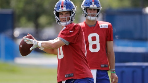 <p>               FILE - In this July 25, 2019, file photo, New York Giants' quarterback Eli Manning throws a pass as Daniel Jones watches at the NFL football team's training camp in East Rutherford, N.J. Eli Manning is entering a team-record 16th season with the New York Giants and his career in some ways might be coming full cycle. (AP Photo/Frank Franklin II, File)             </p>