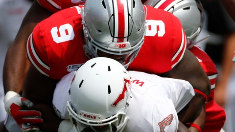 <p>               Ohio State defenders Baron Browning, top, and Jashon Cornell, tackle Florida Atlantic receiver Willie Wright during the first half of an NCAA college football game Saturday, Aug. 31, 2019, in Columbus, Ohio. (AP Photo/Jay LaPrete)             </p>