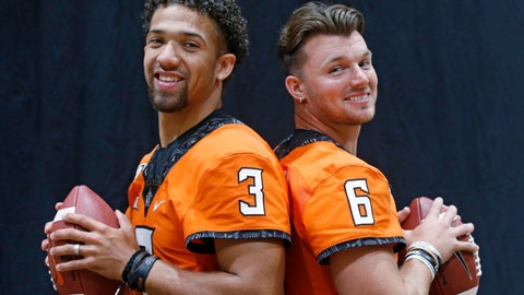 <p>               FILE - In this Saturday, Aug. 3, 2019, file photo, Oklahoma State quarterbacks Spencer Sanders, left, and Dru Brown, right, pose for a photo during the NCAA college football team's media day in Stillwater Okla. Oklahoma State coach Mike Gundy says he considers both capable of starting. (AP Photo/Sue Ogrocki, File)             </p>