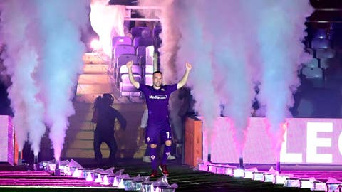 <p>               Newly hired French forward of Fiorentina, Franck Ribery acknowledges the crowd as he is officially presented in Florence, Italy, Thursday, Aug. 22, 2019. (Claudio Giovannini/ANSA via AP)             </p>