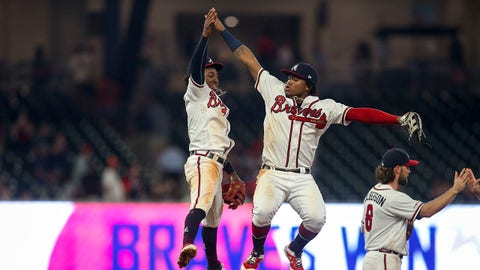 Aug 13, 2019; Atlanta, GA, USA; Atlanta Braves second baseman Ozzie Albies (1) and center fielder Ronald Acuna Jr. (13) celebrate after defeating the New York Mets at SunTrust Park. Mandatory Credit: Brett Davis-USA TODAY Sports