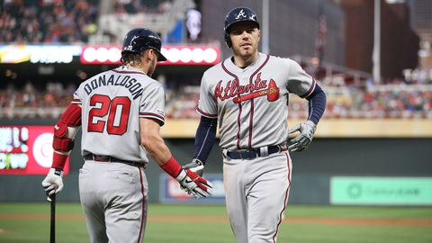 Aug 5, 2019; Minneapolis, MN, USA; Atlanta Braves first baseman Freddie Freeman (5) celebrates a home run with third baseman Josh Donaldson (20) in the fifth inning against the Minnesota Twins at Target Field. Mandatory Credit: Ben Ludeman-USA TODAY Sports