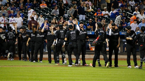 Aug 24, 2019; New York City, NY, USA; The Atlanta Braves celebrate after defeating the New York Mets during an MLB Players' Weekend game at Citi Field. Mandatory Credit: Andy Marlin-USA TODAY Sports
