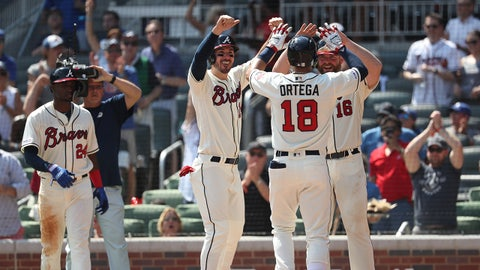 Aug 18, 2019; Atlanta, GA, USA; Atlanta Braves left fielder Rafael Ortega (18) celebrates his grand slam with right fielder Matt Joyce (14, left) and catcher Brian McCann (16) in the sixth inning against the Los Angeles Dodgers at SunTrust Park. Mandatory Credit: Jason Getz-USA TODAY Sports