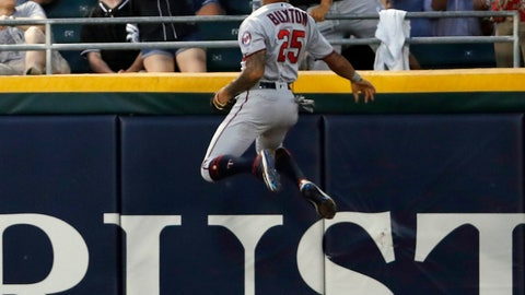 <p>               Minnesota Twins center fielder Byron Buxton (25) climbs the wall trying to catch the home run ball hit by Chicago White Sox center fielder Adam Engel (not pictured) during third inning of a baseball game Friday, July 26, 2019, in Chicago. (AP Photo/Jeff Haynes)             </p>