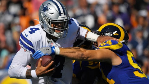 <p>               Dallas Cowboys quarterback Dak Prescott, left, is sacked by Los Angeles Rams linebacker Bryce Hager and another defender during the first half of a preseason NFL football game Saturday, Aug. 17, 2019, in Honolulu. (AP Photo/Mark J. Terrill)             </p>