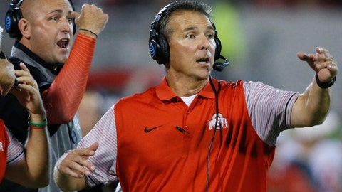 <p>               FILE - In this Sept. 17, 2016, file photo, Ohio State coach Urban Meyer, right, and assistant coach Zach Smith, left, gesture from the sideline during the team's NCAA college football game against Oklahoma in Norman, Okla. Meyer encouraged Smith to stay with the Buckeyes in January 2018 after the then-assistant coach was pursued by Alabama, according to texts messages from Meyer to Smith. On Friday, Aug. 2, 2019, Ohio State released thousands of pages of heavily redacted texts and email that were part of an external investigation conducted last August into Meyer's handling of Smith and what he knew about allegations of domestic violence made by Smith's ex-wife, Courtney Smith. Meyer was suspended for the first three games of last season by Ohio State after the investigation. After the season he retired at 54, citing health concerns. He is now working as an analyst with Fox Sports. (AP Photo/Sue Ogrocki, File)             </p>