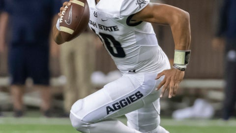 <p>               FILE - In this Saturday, Nov. 3, 2018, file photo, Utah State quarterback Jordan Love rolls out looking for an open receiver in the first half of an NCAA college football game against Hawaii in Honolulu. Love, who posted big numbers a season ago, is now being hyped for the Heisman Trophy. (AP Photo/Eugene Tanner, File)             </p>