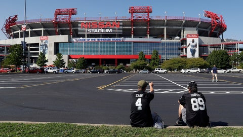 <p>               FILE - In this Sept. 10, 2017, file photo, Devin Walsh, left, and his father, Gerard Walsh, wait outside Nissan Stadium before an NFL football game between the Tennessee Titans and the Oakland Raiders  in Nashville, Tenn. The Titans have had trouble filling their stadium for years and have needed the help of visiting fans to sell as many seats as they have. The sales office stays busy pitching ticket deals to a stadium built in the late 1990s. Not even the first three-year stretch of winning seasons since relocating to Tennessee has helped yet. So the Titans are getting more creative. (AP Photo/James Kenney, File)             </p>
