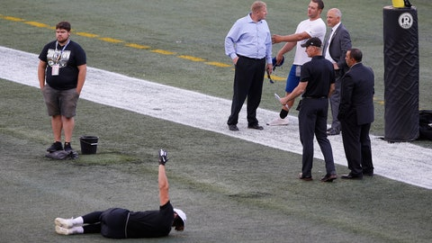 <p>               Officials assess the location where the CFL goal post holes were, before an NFL preseason football game between the Oakland Raiders and the Green Bay Packers in Winnipeg, Manitoba, Thursday, Aug. 22, 2019. In the NFL the field goal posts are located at the back of the end zone and the Canadian Football League has the posts at the front of the end zone. (John Woods/The Canadian Press via AP)             </p>