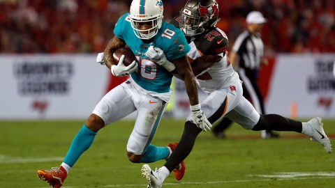 <p>               Tampa Bay Buccaneers defensive back Sean Murphy-Bunting (26) grabs Miami Dolphins wide receiver Kenny Stills (10) after a reception during the first half of an NFL preseason football game Friday, Aug. 16, 2019, in Tampa, Fla. (AP Photo/Mark LoMoglio)             </p>