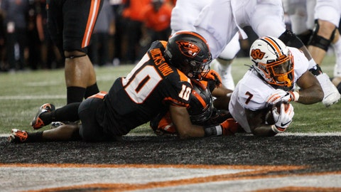 <p>               Oklahoma State running back LD Brown (7) narrowly makes it into the end zone for a touchdown despite defense from Oregon State defensive back Omar Hicks-Onu (10) and inside linebacker Omar Speights (36) during the first half of an NCAA college football game in Corvallis, Ore., Friday, Aug. 30, 2019. (AP Photo/Amanda Loman)             </p>