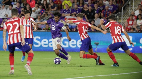 <p>               Los Angeles FC forward Carlos Vela (10) tries to moves the ball past Atletico Madrid midfielder Marcos Llorente (14), defender Felipe (18) and defender Mario Hermoso (22) during the first half of the MLS All-Star soccer match Wednesday, July 31, 2019, in Orlando, Fla. (AP Photo/John Raoux)             </p>