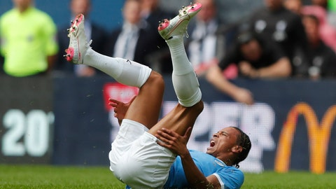 <p>               Manchester City's Leroy Sane lies injured on the ground after a collision with Liverpool's Trent Alexander-Arnold during the Community Shield soccer match between Manchester City and Liverpool at Wembley Stadium in London, Sunday, Aug. 4, 2019. (AP Photo/Frank Augstein)             </p>