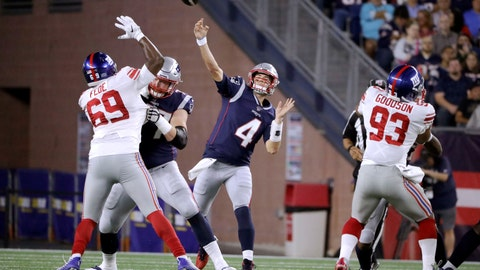 <p>               New England Patriots quarterback Jarrett Stidham (4) throws a touchdown pass to Demaryius Thomas under pressure from New York Giants defensive end Terrence Fede (69) and middle linebacker B.J. Goodson (93) in the first half of an NFL preseason football game, Thursday, Aug. 29, 2019, in Foxborough, Mass. (AP Photo/Steven Senne)             </p>
