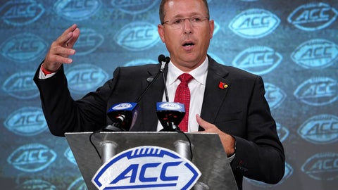 <p>               FILE - In this July 17, 2019, file photo, Louisville head coach Scott Satterfield speaks during the Atlantic Coast Conference NCAA college football media day in Charlotte, N.C. Another season begins for the Louisville Cardinals with another new defensive coordinator and system to learn. Satterfield expects growing pains with the transition, but he's encouraged by Louisville's effort so far.(AP Photo/Chuck Burton, File)             </p>