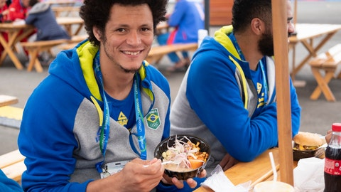 <p>               In this Aug. 3, 2019 photo, Thiagus Petrus, a member of the Brazilian handball team poses for photos while he takes a break from eating ceviche at the international center outside the Pan American athletes' village in Lima, Peru. Peruvian food was the star at the recent Pan Am Games. Athletes from 41 countries across the Americas tasted the highly-regarded cuisine that blends indigenous traditions with European, African and Asian influences with an abundance of seafood from the Pacific Ocean's cold Humboldt current. (AP Photo/Luis Andres Henao)             </p>