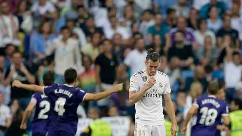 <p>               Real Madrid's Gareth Bale reacts as Valladolid's Sergi Guardiola celebrates after scoring his side's first goal during the Spanish La Liga soccer match between Real Madrid and Valladolid at the Santiago Bernabeu stadium in Madrid, Spain, Saturday, Aug. 24, 2019. (AP Photo/Paul White)             </p>